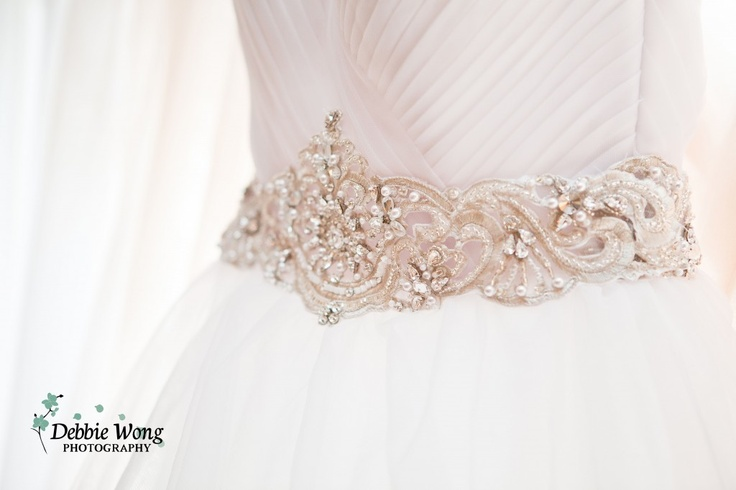 Sparkly belt for the wedding dress embellishment.   Debbie Wong Photography, Calgary wedding photography, www.debbiewongphotography.com