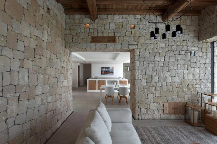 Driessen House designed with two different textures, stone and white features awesome sea views - CAANdesign