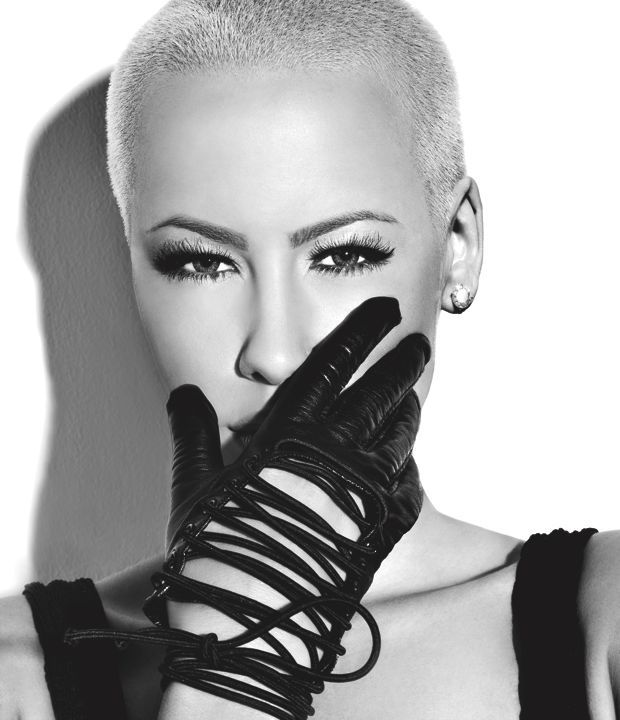 """Amber Rose (born Amber Levonchuck), model, recording artist, actress and socialite, who grew to fame from her relationship with Kanye's West. She has posed for Louis Vuitton and Smirnoff ads, and appeared in music videos such as Ludacris' """"What Them Girls Like"""", Young Jeezy's """"Vacation"""", Mary Mary's """"God in Me"""", Nicki Minaj's """"Massive Attack"""", Fabolous' """"You Be Killin' Em"""" and Wiz Khalifa's """"No Sleep"""". She is engaged to Wiz Khalifa."""