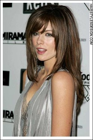 This straight hairstyle is sexy and chic. Kate Beckinsales long hair falls beautifully down her back with bangs on the forehead. The hair frames her face nicely.  Hair Cut: Kate Beckinsales haircut is very long which has been layered as well.  How come i dont look like that Lol