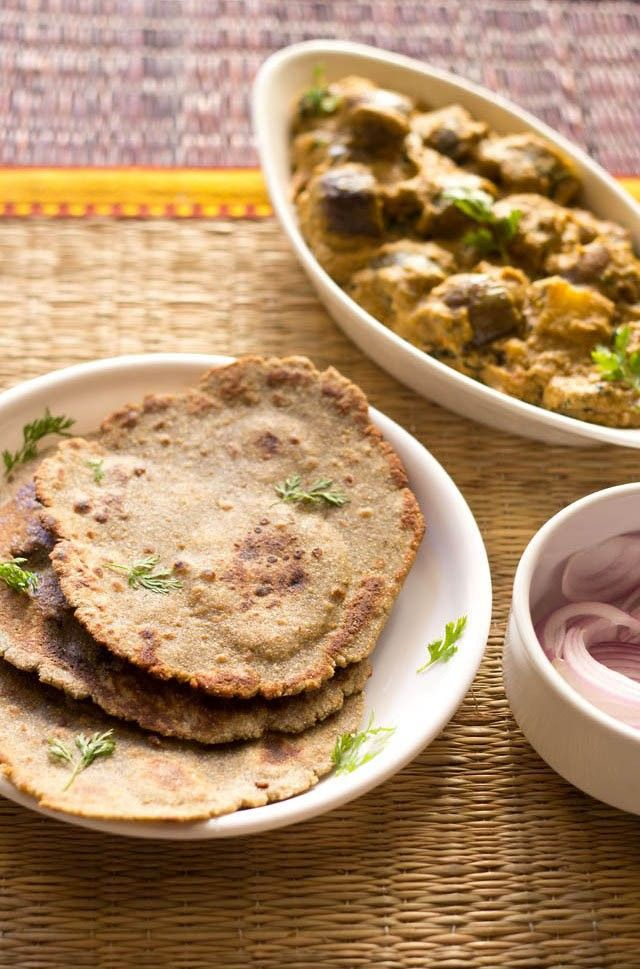 bajra roti or bajra bhakri recipe with step by step photos. bajra bhakri are flat breads made from millet flour. bajra rotis are easy to make and make a good accompaniment to dal.
