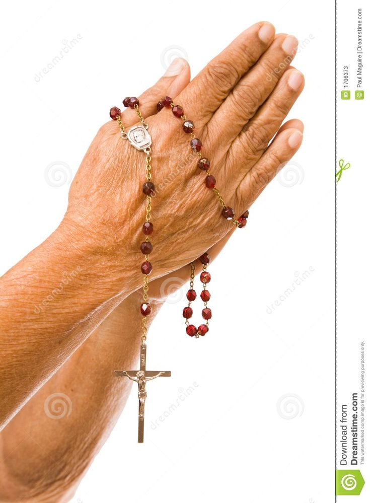 Women Praying Hands | An old asian woman holds her hands in prayer with a rosary.