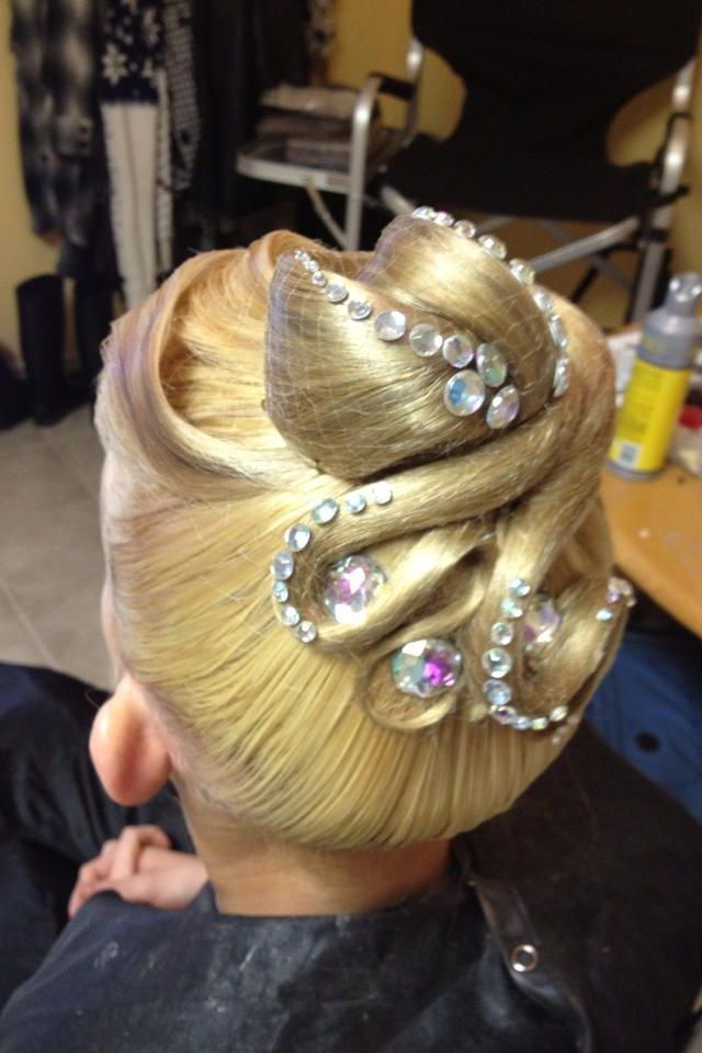 Ballroom hair with rhinestones, mainly used for standard. This hairstyle works well with lightweight hair. Visit http://ballroomguide.com/comp/hair_make_up.html for more hair and makeup info