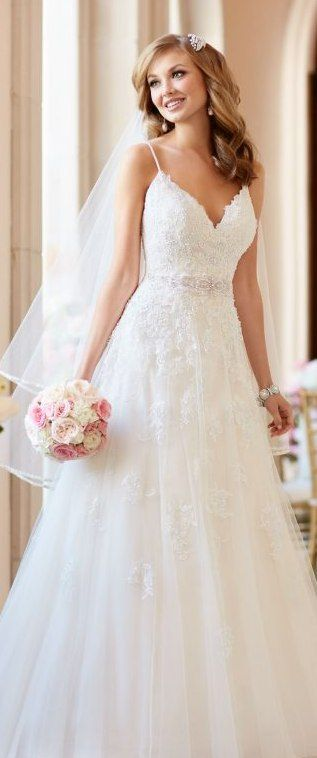 Lace A-line wedding dress with soft tulle skirt.