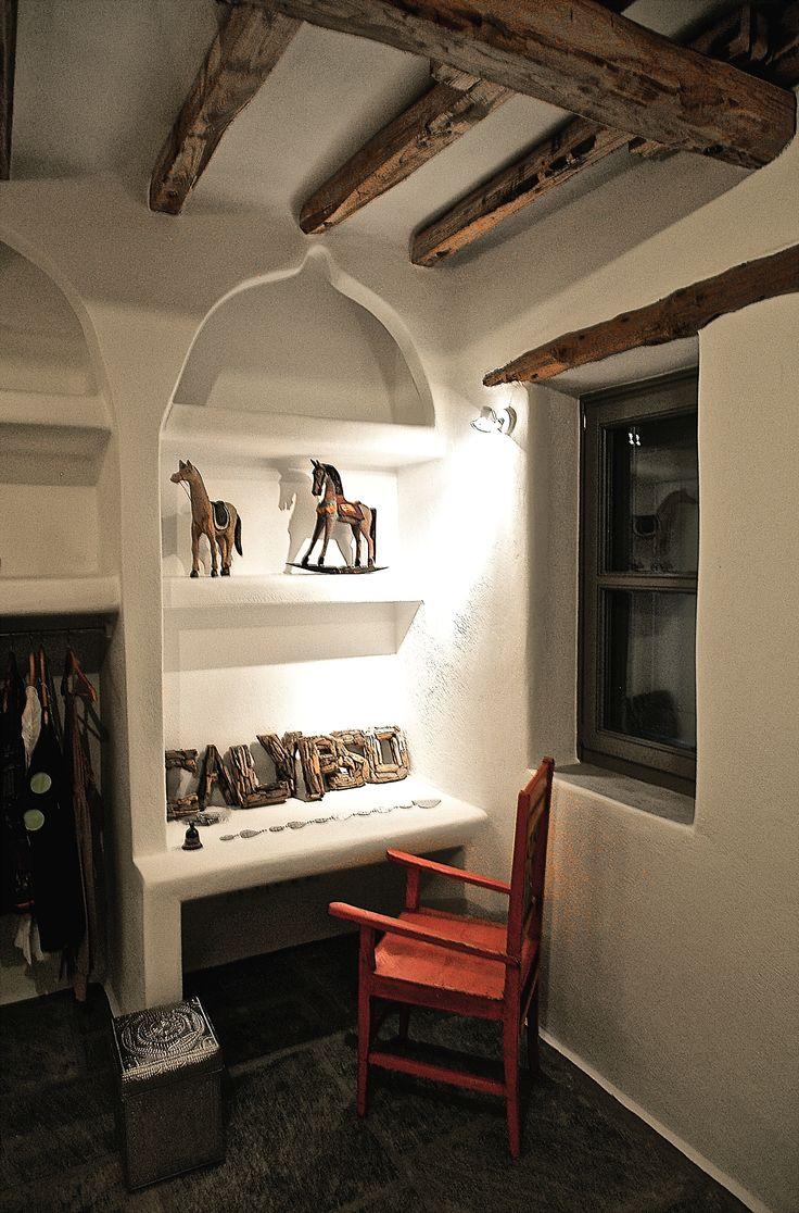 Oriental style open closet and desk.