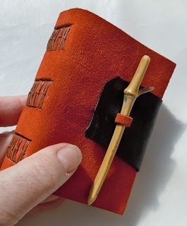Handmade journal by Chad Alice Hagen. Cool loop/stick closure with contrasting…
