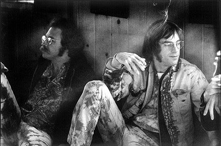 """Wacco and John Sebastian, Jemez Mountains, New Mexico, 1969. After Woodstock, musicians and organizers like Sebastian, Carl Gottlieb, Ken Kesey, Paul Krassner, and Peter Yarrow gathered at the """"Sympowowsium"""" to discuss more equitable treatment of audiences and performers at future musical events."""