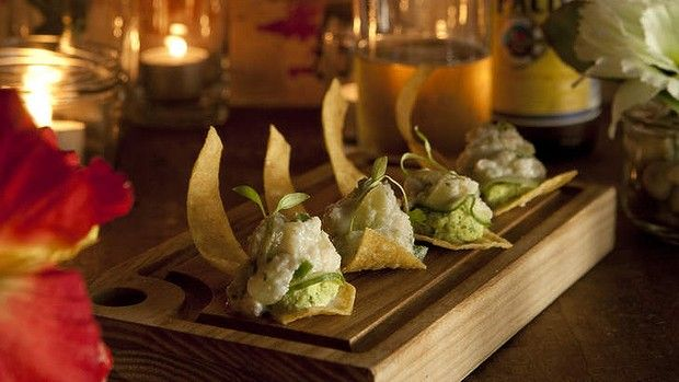 Tostaditas of crab, almond and green onion mojo, cucumber, lime, grape.