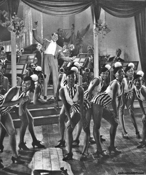 Cab Calloway and his orchestra with the Cotton Club Chorus at the Cotton Club, 1936.