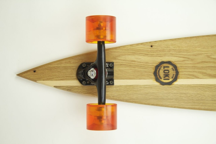 Loki Longboards.  Loki is the Norse god of Transformation.  These longboards were made from old and no longer used pieces of furniture.