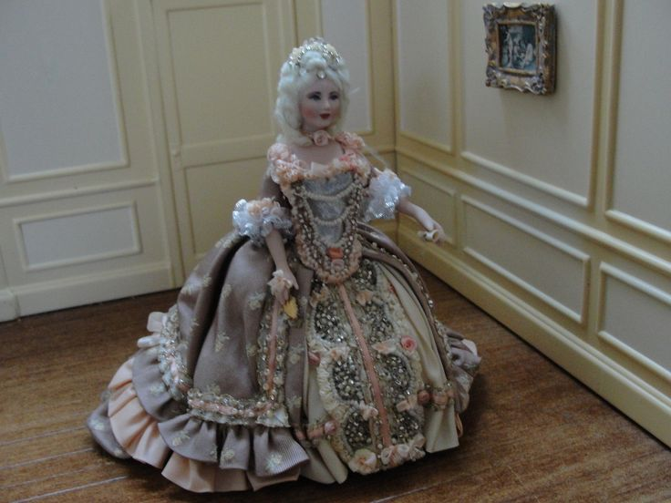 """Jacqueline Polier - French aristocrat wearing a one of a kind beaded gown. This doll measures 5 1/2"""" tall. The gown is done in colors of a peachy-pink with deep beige. This gown has incredible beadwork all down the front as well as along the bottom of her skirt. She has platinum hair adorned with rhinestones and pearls. Her undergarments contain multiple petticoats and beautifully finished pantaloons. sold on ebay for $499"""