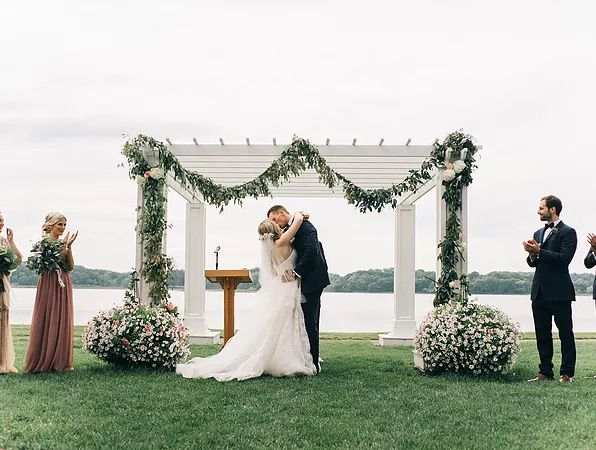 Nature-inspired wedding at Waldenwoods, Hartland, Michigan / Bride is wearing Watters Edlin from Something White / Photo by Sean Cook