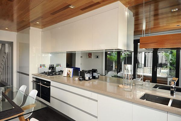 Mirror splashback ideal for making a small kitchen feel for Perfect galley kitchen