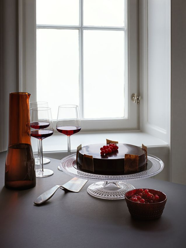 Combining Iittala's classics in red from Teema, Taika or Origo series with Kastehelmi and Essence gives the Christmas table setting a festive mood. www.iittala.com/set-the-table