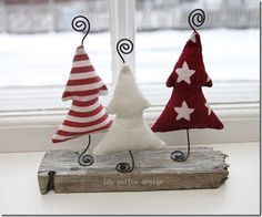 Christmas trees - photo inspiration - draw a simple Christmas tree, cut template; cut 3 sets of trees - seam together, turn inside out, stuff, insert wire, curling at each end;  attach bases to old wood base or driftwood...