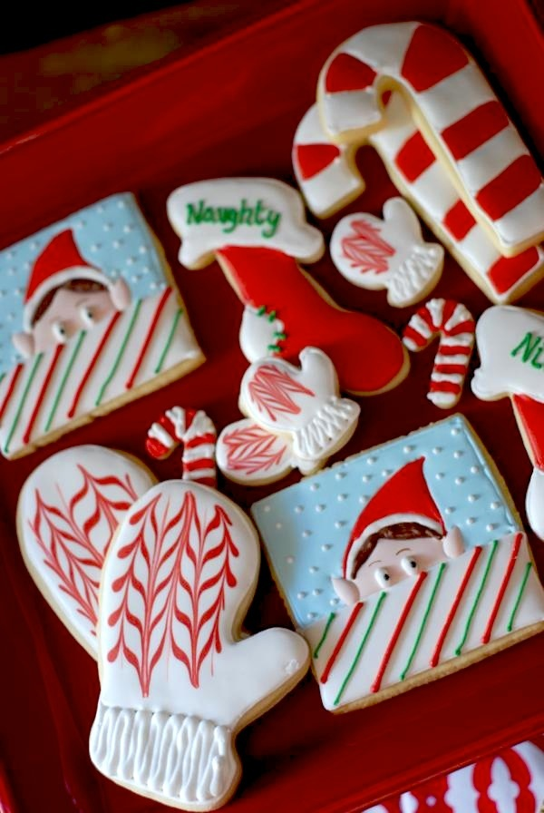 candy cane and stocking decorated cookies