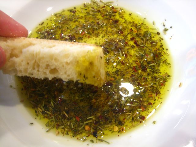 Olive Oil & Herb Bread Dip. 1 tsp crushed red pepper  1 tsp ground black pepper  1 tsp dried oregano  1 tsp dried rosemary  1 tsp dried basil  1 tsp dried parsley  1/2 tsp garlic powder  1 tsp minced garlic. Put all ingredients except olive oil into a shallow bowl or deep plate. Mix.  Pour 1/4-1/2 c olive oil on top to cover the herbs.