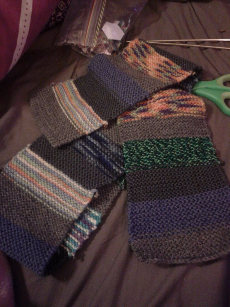 Child Scarf #1 Uses various coloured wool on a base of two types of grey.