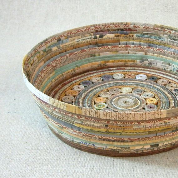 The warm, earthy tones of these unique paper bowls make them the perfect addition to your counter-top, mantel, or display.  The bowls are made from recycled and reused scraps of paper from a variety of sources, giving them a unique combination of colors, hues, and textures. Strips of paper are cut, folded, and twisted into little spirals to form the base…strips are then wrapped upward from the base to create the finished shape. The bowl is protected with a light layer of non-toxic glue and…