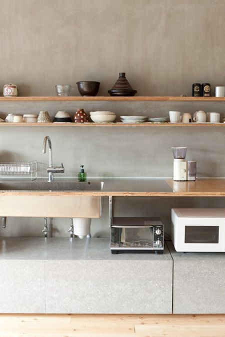 Unconventional form of the cabinets on the floor. I like how it creates the space for kitchen tools.