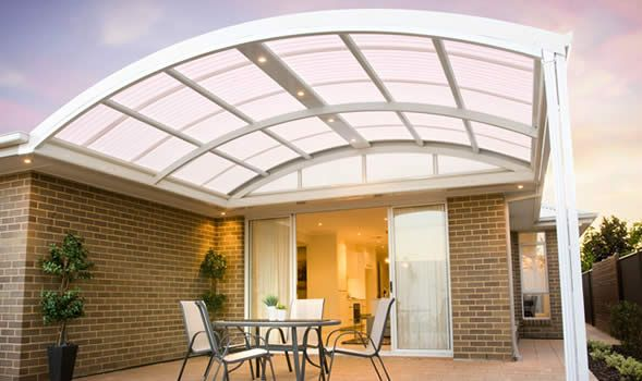 Curved verandah with Laserlite Opal polycarbonate roof. Looks good with all white colour scheme.