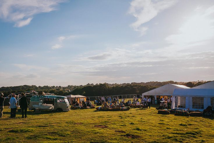 The perfect festival DIY wedding in the Kent countryside at sunset. Photo by Benjamin Stuart Photography #weddingphotography #festivalwedding #DIYwedding #outdoorwedding #weddingideas #kentwedding