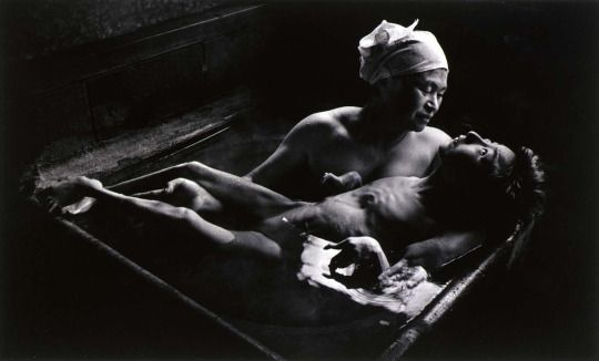 Tomoko in Her Bath, Mother and daughter with Minamata Disease, Japan, 1971. Photographed by W. Eugene Smith.