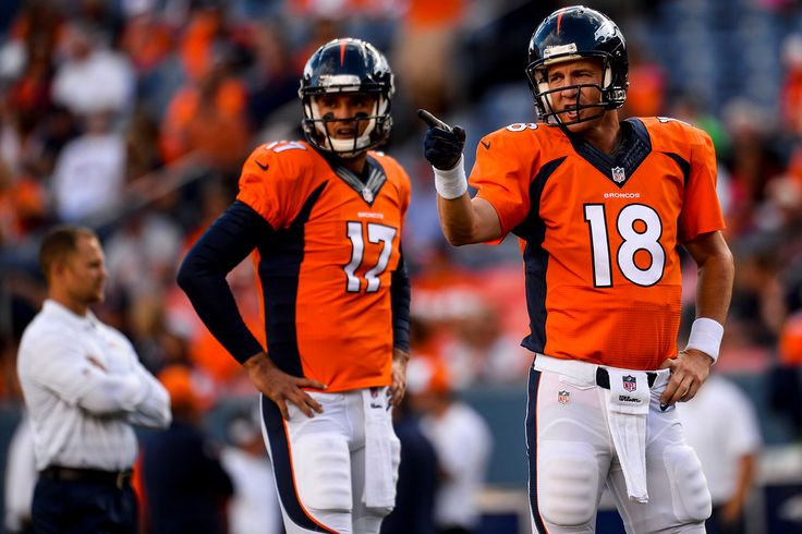 . Peyton Manning (18) and Brock Osweiler (17) of the Denver Broncos warm up before the start of a preseason football game at Sports Authority Field at Mile High on Saturday, August 23, 2014 in Denver, Colorado.  (Photo by Steve Nehf/The Denver Post)