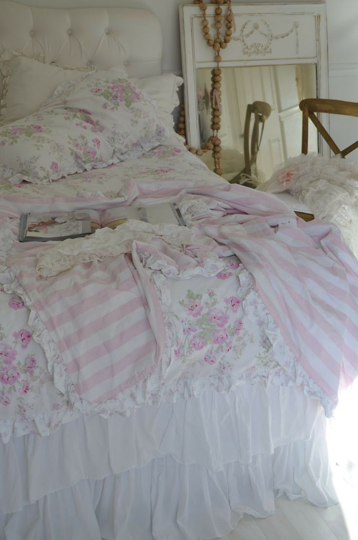 this is the simply shabby chic bedding from target perfect for spring i love the pink and white stripes on the back my dresser with a littl