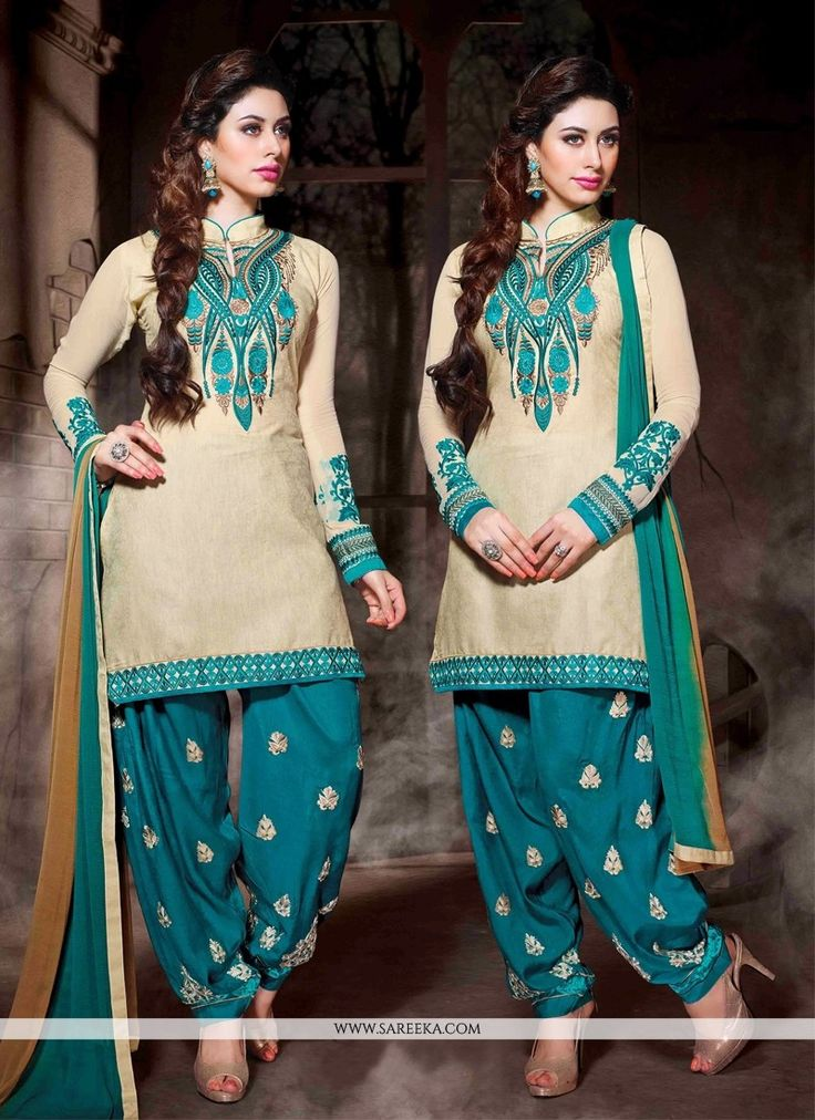 Cream cotton silk punjabi salwar suit with embroidery, resham, zari, lace and patch border work. As shown an matching bottom and dupatta comes with this.(Slight variation in actual color is possible)....