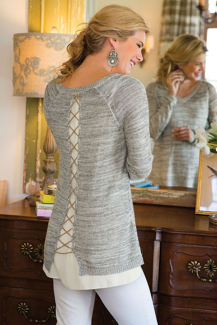 Our Shimmer Down Sweater sports a silver lurex knit with a soft reverse jersey knit.