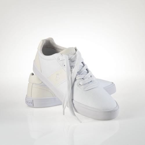 This classic canvas sneaker features smooth leather accents and our signature pony embroidery. Lace-up front. Polo -debossed leather patch on tongue. Padded insole for shock absorption....