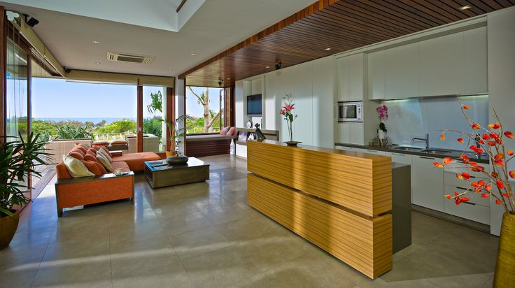 Open-plan living in a beach-front, Balinese inspired, family home located in Salt Village, Kingscliff, New South Wales, Australia. Built by Seabreeze Homes. Designed by Grounds Kent Architects.