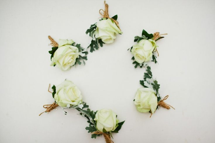 ivory rose and twine buttonholes Elegant wedding in a tent in Guildford   Green antlers photography   Destination wedding photography  London based