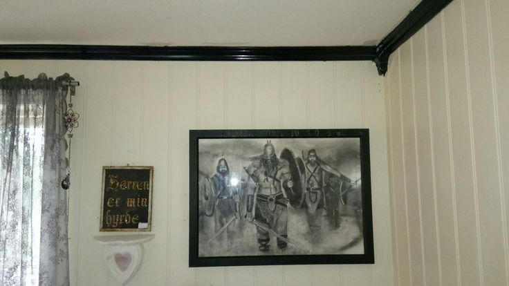 My sister gave me this drawing of celtic warriors,she made it with coal.