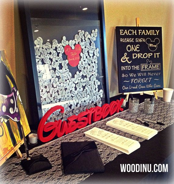 Wedding Guestbook Alternative - Disney Wedding Guestbook Alternative - Customized & Includes Mickey Signature Mementos  Alternative Wedding Guestbooks are a fun way to remember your special day! Our Disney inspired Guestbook is designed of wood with a black framed shadow box with an opening across the top of the frame allowing your guests to drop their signed memento into the shadow box. The mementos for this box are 2 1/4 silver glitter Mickey Mouse ears made of wood. The center Mic...