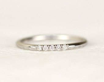 14k yellow solid gold micropave set with white diamonds. -This band measures approximately 1.30mm thickness in full round. -1mm white diamond,