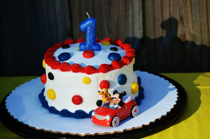 So I didn't want a huge cake for the party I just wanted a little smash cake for my son and the rest of the guess would have cup cakes. It just makes it easier to serve cupcakes with a lot of people. So I went to my local Walmart and told them I wanted a smash cake made and I was doing Mickey Mouse theme but I wanted to design it my way. So we came up with this simple but yet cute cake and I bought the Mickey Mouse kit from them that they use on there Mickey Mouse cake.