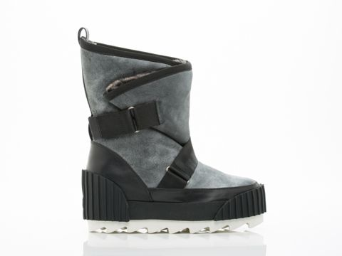 """SNOW BOOTIE BY UNITED NUDE ($395) You know that trip to Antartica you want to make? We found your perfect boot for it. Slide your foot into these faux fur lined boots with 1 1/2"""" platform, velcro straps, and rubber bumpers. Leather upper, faux fur lining, man made sole. Fits true to size. Size US8 (EU 38) insole measures 9 5/8"""" or 24.5 cm. Each whole size is 1/2"""" or 1cm difference.  A United Nude original.  Women's shoe. Imported."""