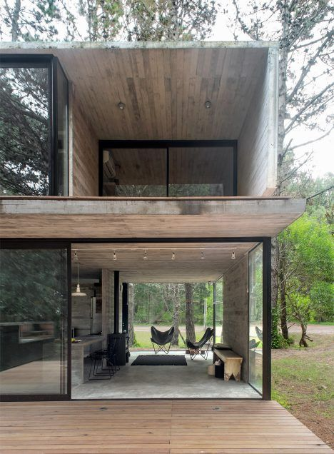 This concrete summer house by Argentinian architect Luciano Kruk stands among…