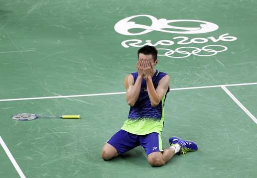 Malaysia's Lee beats two-time Olympic champion Lin of China:  August 19, 2016  -    Malaysia's Lee Chong Wei celebrates after defeating China's Lin Dan in their men's badminton singles semifinal match at the 2016 Summer Olympics in Rio de Janeiro, Brazil, Friday, Aug. 19, 2016. (AP Photo/Mark Humphrey)