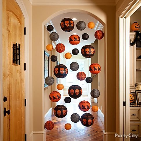 TIP : Haunt your hallways If you're nervous about guests getting too cozy in your home, block off hallways or off-limits parts of your house with hanging decorations. It's a polite way to let guests know that some areas are not open during the party. Try hanging Halloween-themed lanterns, and you could even mix in fans or streamers for a wicked display.