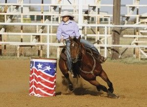 Pro barrel racer Michele McLeod teaches you how to shave time off your runs with correct body position and control of your horse's speed around barrels.