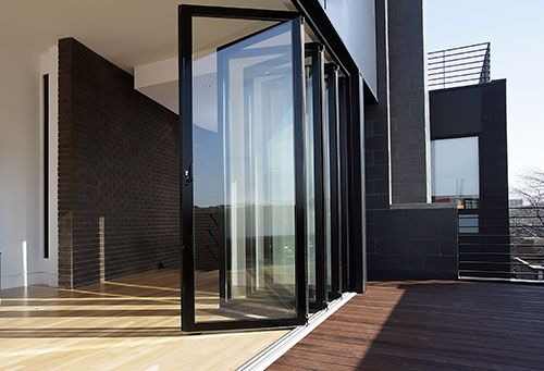 Bi-folding black door system with high security locks