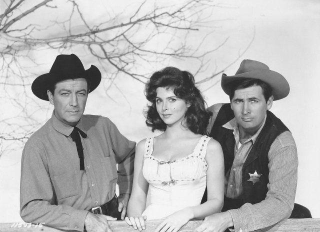 Tina Louise, Robert Taylor, and Fess Parker in The Hangman (1959)