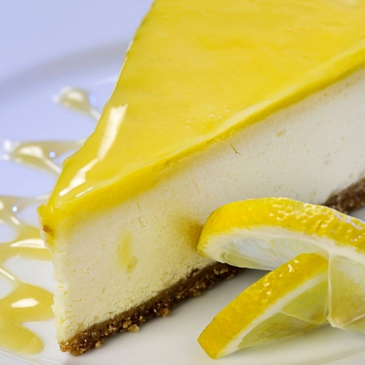 A perfect cheesecake recipe with a tangy lemon glaze.. Lemon Glazed Cheesecake Recipe from Grandmothers Kitchen.