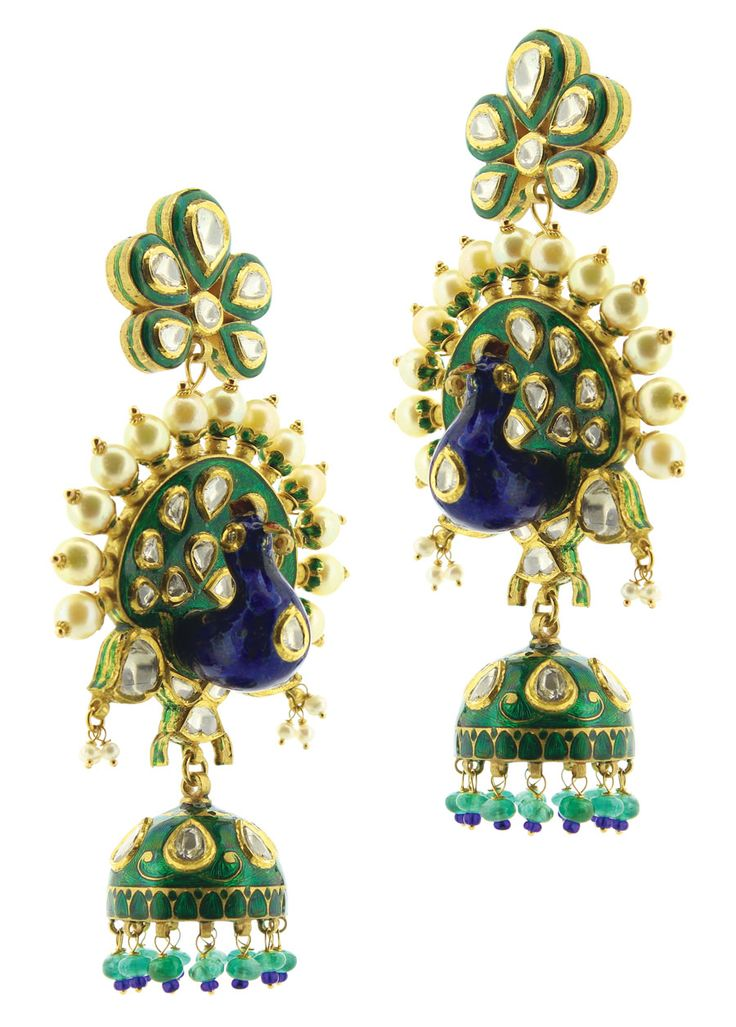 Sunita Shekhawat's (celebrity Indian Jewelry designer) three-dimensional peacock earrings studded with polki, pearls and enamel. The peacock is the national bird of India.