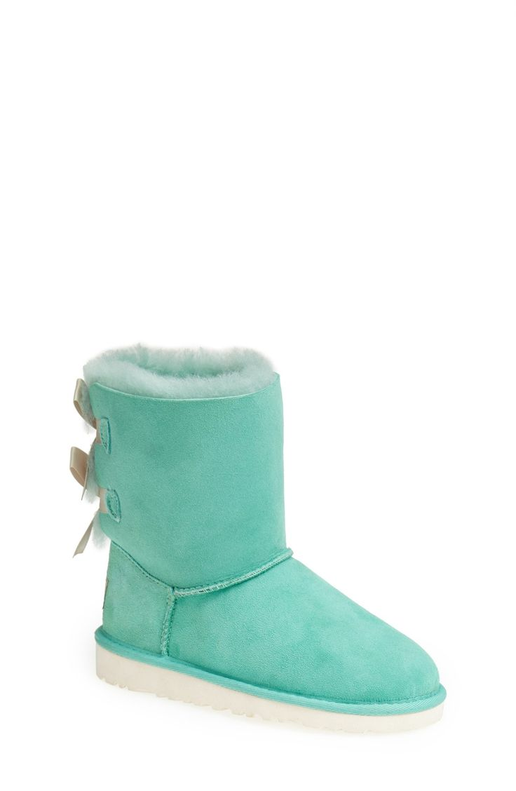 Tiny mint green UGGs with bows on the back.