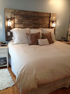The headboard my husband made me out of reclaimed barn lumber and candle lanterns. Love it!!