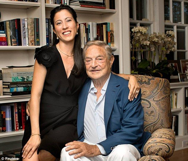 Newlyweds: Billionaire investor George Soros pictured with wife Tamiko Bolton who is now the owner of a Manhattan condo Ferreyr claims was promised to her